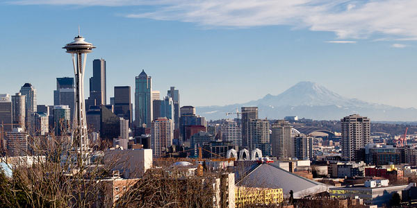 The Seattle Space Needle with Mount Rainier in the background.